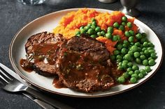 Slow Cooker Balsamic-Braised Pot Roast—Weeknight entertaining is a breeze when you put your slow cooker to work! Adding a bit of flour to the sauce at the end of cooking turns it into a rich gravy to serve alongside the roast. Green peas and mashed sweet potatoes make great accompaniments to this hearty cold-weather dish.