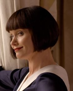 Phyne's sassy bob - Series 1 Episode 1 - blue sailor suit - close up - Miss Fisher's Murder Mysteries - Phyrne Fisher