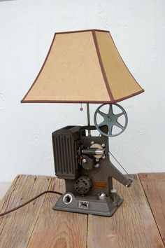 I can make this for my living room Cool Lighting, Industrial Lighting, Lighting Design, I Love Lamp, Steampunk Lamp, Chandelier Shades, Vintage Cameras, Repurposed Furniture, My Living Room