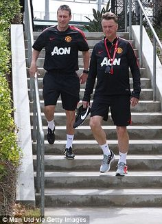 Van Gaal and Fitness Coach Tony Strudwick make it down the stairs