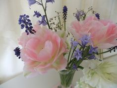 Bedroom posy of spring tulips, bluebells and muscari