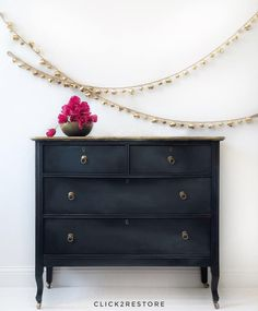 Black beauty with gold highlights It has a blending of grey's and white and a distressed gold patterned top.All Drawers are lined and waxed in a lavender scent. Classic and vintage beauty to shine forever.