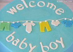 Welcome Baby Boy Clothes Line Baby Shower Cake ~    Baby Boy Shower Cake ~    This an 8″ round vanilla cake filled and frosted with vanilla buttercream.    How to Decorate @  http://rosebakes.com/welcome-baby-boy-clothes-line-baby-shower-cake/?utm_source=rss_medium=rss_campaign=welcome-baby-boy-clothes-line-baby-shower-cake