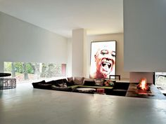 best sunken living room, ever - I like it, but that pic in the background creeps me out