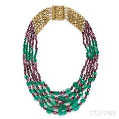 Emerald and Purple Spinel Bead Necklace, composed of five strands of graduating emerald and spinel beads, with gold and foil-back diamond links, and completed by a gold clasp of diamond-set floral and foliate motifs, reverse with counter-enamel, lg. 20 in.