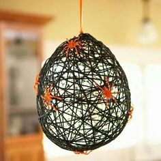 Glue twine to balloons pop when dry and make spider webs