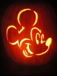 Mickey Mouse Pumkin Carving. Super cute, looks easy enough. Might have to try it this year!