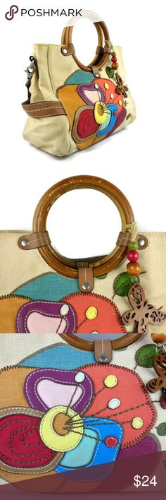 """Relic Canvas Handbag With Floral Pattern Relic Canvas Handbag With Floral Pattern On Front Side.  Wooden Butterfly Dangle.  Round Wooden Handles.  Shoulder Strap Included.  Two Large Open And One Large Zippered Compartment.  Measures 8"""" x 12"""" x 4"""" With A Shoulder Strap Drop Of 20"""".  Such A Cute Bag.  Does Show A Little Wear.  SP  F-2 Relic Bags Shoulder Bags"""