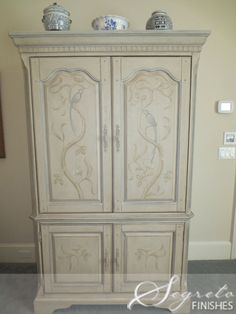 Secrets of Segreto - Segreto Secrets Blog  soft greige with blue and handpainted design on dark mahogany armoire