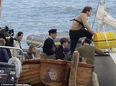 Captain of the ship: Colin was later spotted in a beige jumper as he shot scenes on board ...