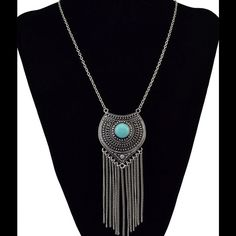 SILVER PLATED PENDANT NECKLACE WITH TASSELS Trendy & fun Pendant Necklace featuring a Turquoise shade center stone & chain tassels. Silver plated. 36 cm necklace diameter, & 12 cm pendant. Comes in vendor bag. No trades. Jewelry Necklaces