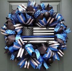 Show your support for Law Enforcement with this Thin Blue Line Wreath. Constructed on a wire wreath frame with four different patterns of Poly Deco Mesh: Metallic Navy/Royal, Metallic Black, Deluxe Wide Foil Royal Blue and Deluxe Wide Foil Metallic Black. Four different coordinating