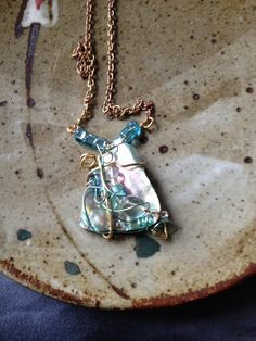 Abalone shell necklace wire wrapped in gold and teal blue wire