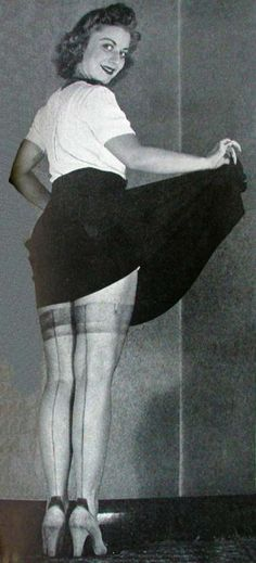 1941 cosmetic-stockings: With nylon or silk hose hard to come by, women had the look of stockings brushed on their legs.