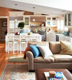 How cute is this living room and kitchen space? See more spaces: http://www.bhg.com/decorating/storage/organization-basics/family-organization-tips