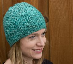 Ravelry: Brangien Hat pattern by Karen Robinson: This hat features a cable panel with the rest of the hat in a textured moss stitch. The fit should be just a little loose, not truly slouchy but not tight either. The hat is knit in the round on circular needles in a fingering weight yarn (a solid or semi-solid is recommended). Click to buy now or repin to save for later.