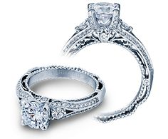 Verragio VENETIAN-5021R.  My loving hubby ordered this ring to custom fit two diamonds I inherited from my mom. I'm so excited!