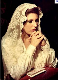 """A mantilla or chapel veil is worn by traditional Catholic women in obedience to 1 Corinthians - """"But every woman praying or prophesying with her head not covered disgraces her head."""" I doubt many prophesy, though. Catholic Veil, Catholic Art, Roman Catholic, Catholic Prayers, Chapel Veil, Alter, Childhood Memories, Christianity, Faith"""