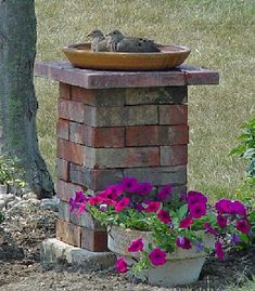 Spruce up your backyard landscape with these incredible DIY brick projects. We hope these yard project ideas inspire you to use reclaimed materials. Brick Projects, Outdoor Projects, Garden Projects, Outdoor Decor, Diy Projects, Indoor Outdoor, Bird Bath Garden, Garden Art, Brick Planter