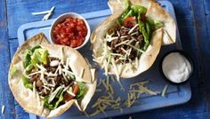 This is one of the gutsiest salads we've come up with – packed with beef and flavour. A proper Hairy Dieters' feast. If you like, you can also make this with ready-made taco shells which are even lower in calories than tortillas so you can eat more filling! This meal provides 397 kcal per portion.