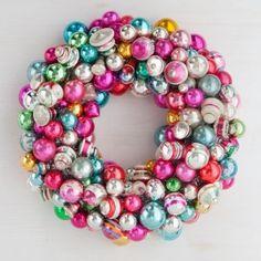 Ornament wreath made with U-pins, not hot glue, so vintage ornaments aren't damaged. Martha Stewart.