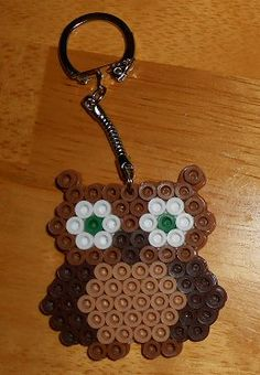 Hoo Hoo Owl  Choice of Color Available as a keychain, cellphone charm, or magnet Handcrafted from Perler Beads www.debbiescraftcorner.com
