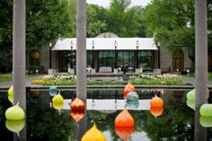 The view of the Spink Pavilion from the Lily Ponds with the Chihuly Onions in the forefront.