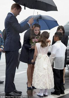 July 2011 - Lovely to meet you: The Duke and Duchess of Cambridge, are greeted by Marco Paol Esteba, right, and Amelie Wood, both eight, in the Northwest Territories