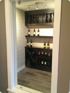 Basement wine room, can fit one under the alcove under the stairs. www.organizedhomeremodeling.com