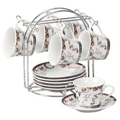 A lovely addition to your dining room sideboard or baker's rack, these espresso cups feature a complementing stand.   Product: ...