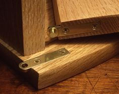 Brusso straight pivot hinges are used for full coverage doors that span the entire opening of the door frame.  Because the hinge is mortised into the carcase and door, and extends to the side, they give a clean modern look to the front of cabinets and