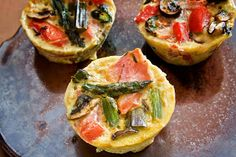 Curry Asparagus Mini Frittatas - perfectly portioned frittatas filled with fresh vegetables and a touch of curry powder makes the favors pop.