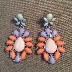 Multi colored earrings Multi colored earrings. One size. They dangle. Light pink centers, peach, lavender, light blue , with silver accents. These are so pretty! Good condition! Jewelry Earrings