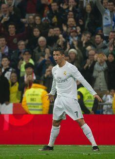Real Madrid's Portuguese forward Cristiano Ronaldo celebrates a goal during the Spanish league football match Real Madrid CF vs RCD Espanyol at the Santiago Bernabeu stadium in Madrid on January 31, 2016.