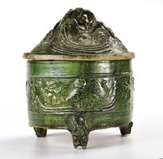 Hill jar and cover of red earthenware with green lead glaze, the cover in the form of a hill, and the jar ornamented with animals and supported on three bear-shaped feet, used to furnish tombs for use in the afterlife: China, Han Dynasty, 206 BC - 220 AD