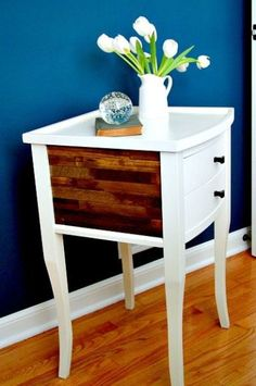 A makeover on a plain, white nightstand using paint sticks, stain and wood glue to tranform it into a rustic, shabby chic statement piece of furniture. #DIY #DIYproject