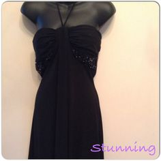 Stunning Black Dress Worn once for a summer wedding.  Stunning beading material and sexy back detailing.  This dress can be worn two different ways - one as a halter with the straps attached, or two as a strapless dress with the straps tucked inside.  The back has a crisscross detailing and then opening to show some skin :). Sexy yet subtle.  The bottom of the dress is flowy with a high middle and lower ends.  Bust is 33 inches, top to middle bottom is 29 inches&top to side ends is 35…