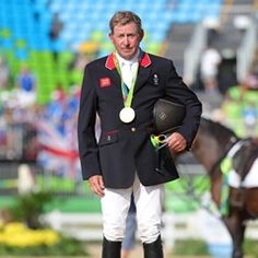 Nick Skelton of Great Britain takes gold in the Olympic Equestrian Jumping Individual Final