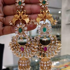 Absolutely Gorgeous Long Jhumkas/Earrings in Silver & Gold Polish with Ruby's,Emeralds,American Diamonds and Pearls -Indian Jewelry Wedding, Jewelry for Wedding, Clothes for Wedding Gold Jhumka Earrings, Jewelry Design Earrings, Gold Earrings Designs, Gold Jewellery Design, Necklace Designs, Buy Earrings, Designer Earrings, Silver Jewellery Indian, Silver Jewelry