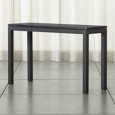 Shop Parsons Black Marble Top/ Dark Steel Base 48x16 Console.   More than meets the eye, the Crate and Barrel Parsons console table is constructed of hot-rolled steel with handcrafted details.