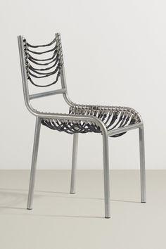 René Herbst; Nickel-Plated Steel and Elastic Cord Chair, 1929.