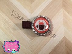 A personal favorite from my Etsy shop https://www.etsy.com/listing/248280175/football-bottle-cap-clip-orange-football