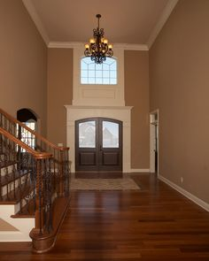 Coffee colored wall paint , dark hardwood floors and white trim. My kitchen and dining room goal scheme!