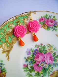 using china plate on a holder as earrings stand in pictures by silly old suitcase