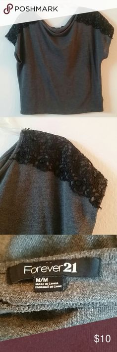 Forever 21 top Beautiful forever 21 grey top with black lace on each shoulder. Forever 21 Tops