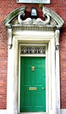 Green Door with Impressive Concrete Trim