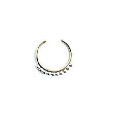 Decorative septum cuff made from 20 gauge 14k gold fill and sterling silver.  No piercing necessary with this adjustable cuff.  Can be worn as an ear or nose cuff as well. approx 10mm wideHow To: Slightly widen gap to fit septum cuff into place and then gently tighten so it stays put.