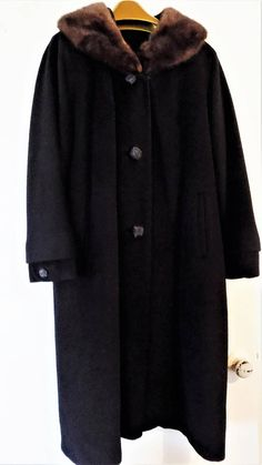 Parkmoor Womens Black Overcoat, Wool with Mink Collar, Vintage Coat by Parkmoor. Burlou Moth Proof. Soft, brown mink fur on the collar, nicely tanned and lined, Then sewn onto the coat. Beautiful deep black wool coat with three large 1 1/2 buttons. Nice slanted lined pockets.