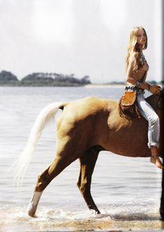 hippie beach girl on horse
