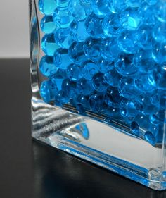 blue water pearls (absorb water) for vases.